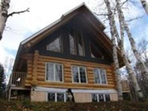 chalets en bois rond Baie-Saint-Paul, Charlevoix